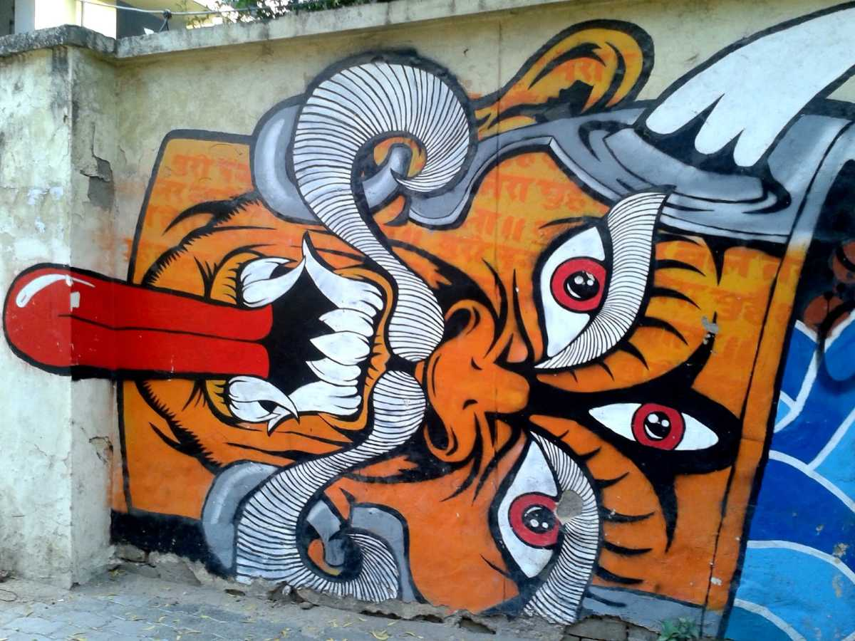 Demon on the wall, DELHI: Near Ganesha mural