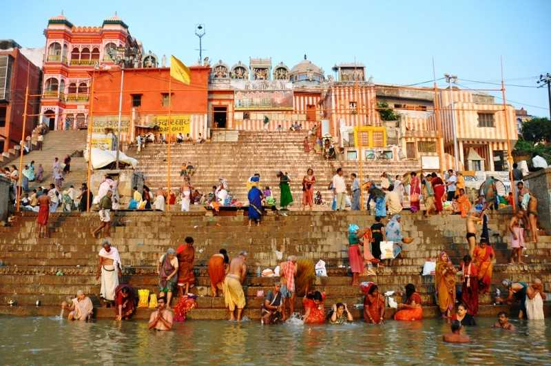 A customary dip in the holy Ganges (Source)