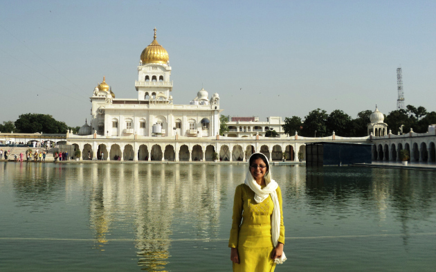 The majestic Guru Bangla Sahib Gurdwara throws its resplendent reflection in the pond