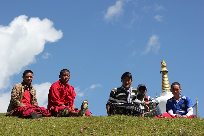 Chilling with young monks on the sunny slopes of Tawang