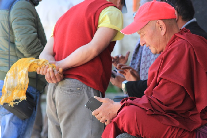 Monks at Tawang monastery on their smartphones