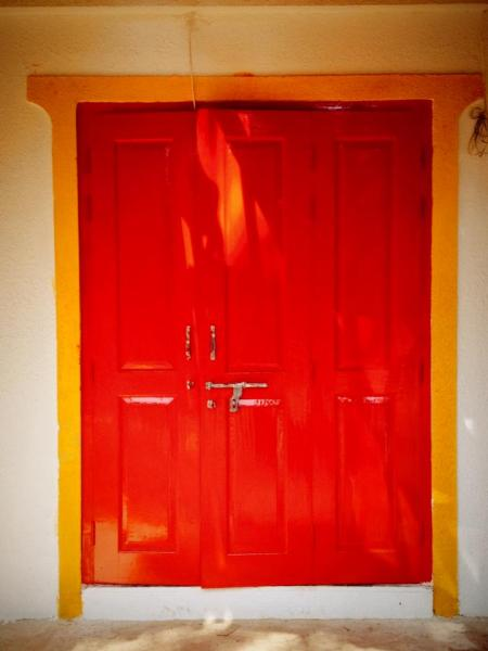 The signature Red Door of the Hostel, a backpackers hostel in India