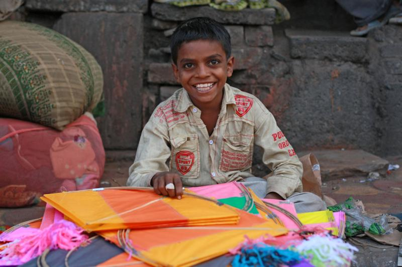A boy happy selling kites, International Kite Festival
