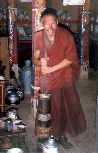 Monk churning butter in Gur Gur