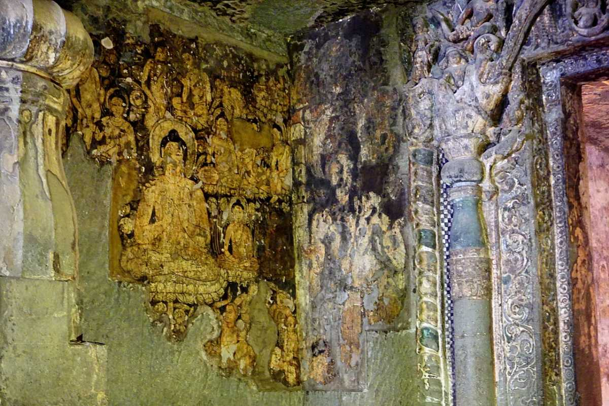 The most intact painting in Cave 6: Buddha seated in dharma-chakra-mudra.