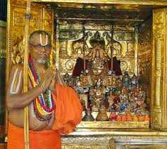 A priest beside a decorated deity