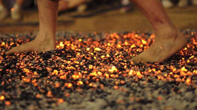 Devotees walking on hot coal during the festival