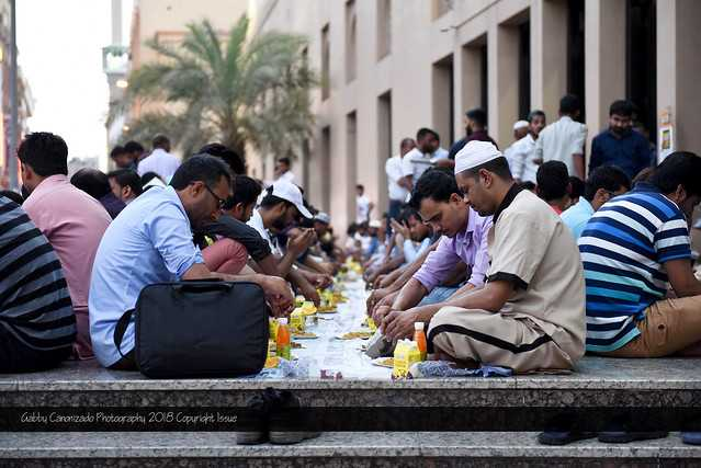 A mosque in UAE providing Iftar (breakfast) meals to Muslims, after sundown, to break their fasts during Ramadan