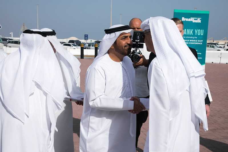 Men in UAE greeting each other with a steady handshake