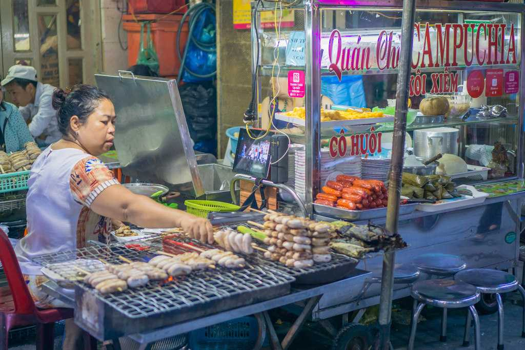Street Food Vendor in Pham Ngu Lao Street