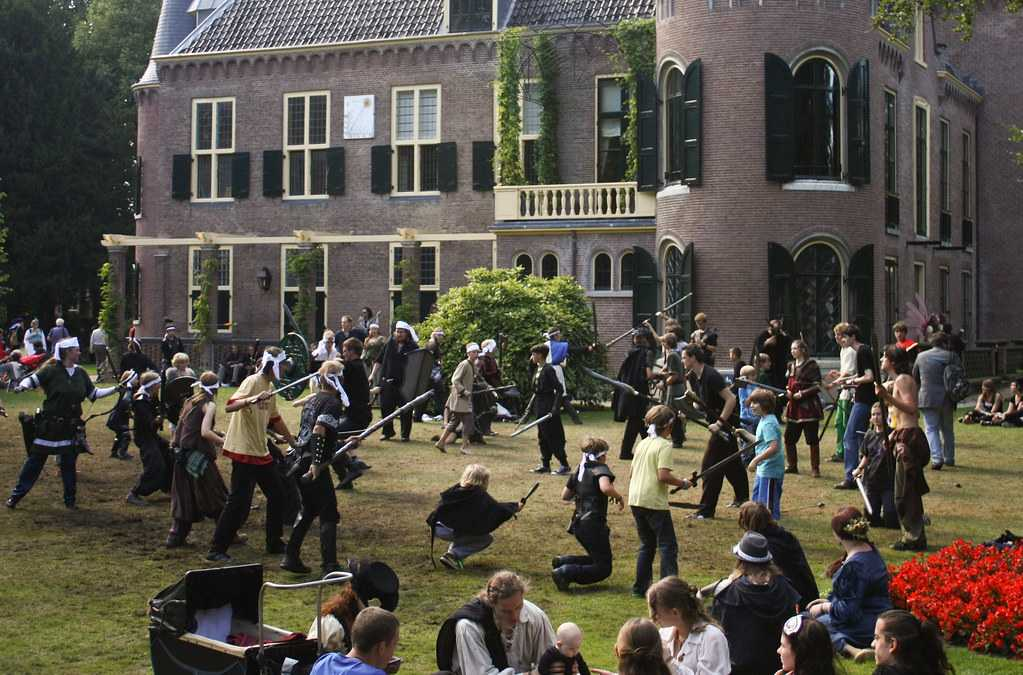 Kids engaged in a combat in front of the Castlefest Castle in 2011