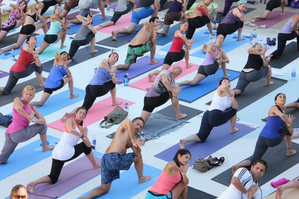 People performing Yoga