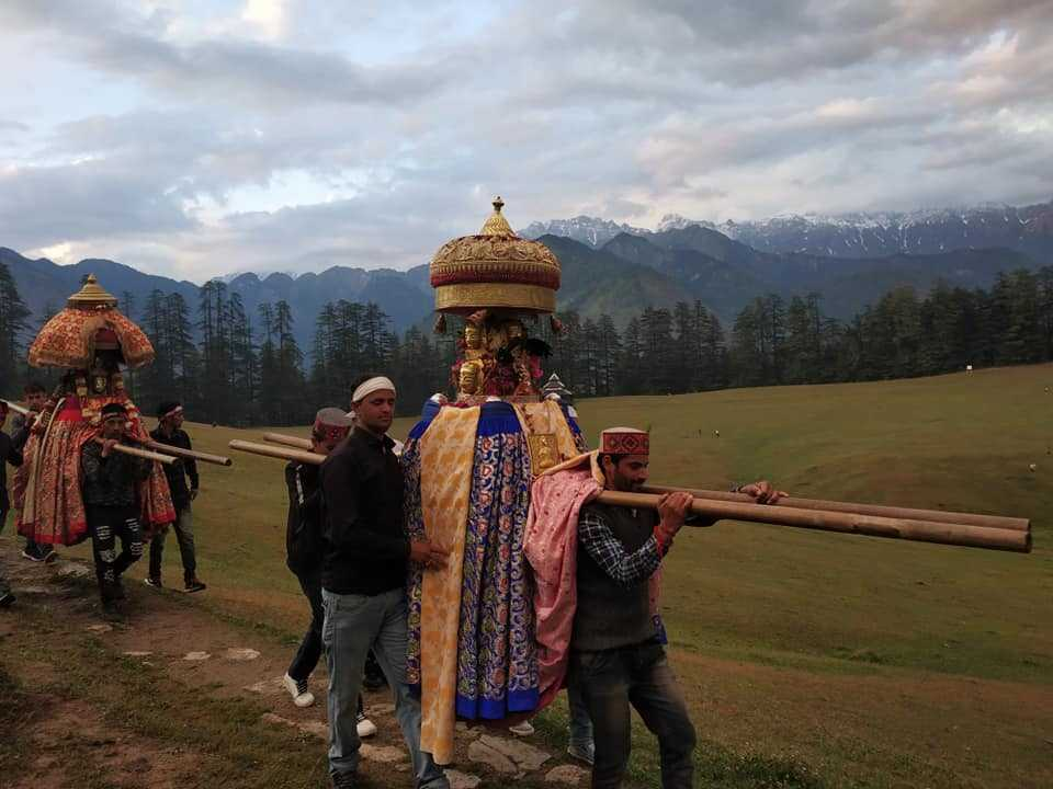 Locals taking deity on a procession at Shangarh