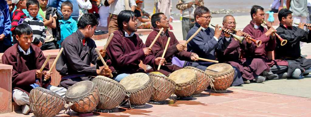 Locals playing traditional folk instruments