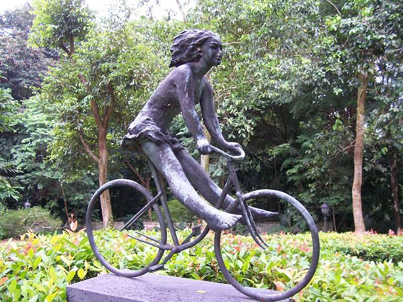 Girl on a Bicycle Sculpture at Singapore Botanic Gardens