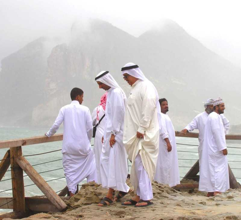 Arab men attired in long Kanduras