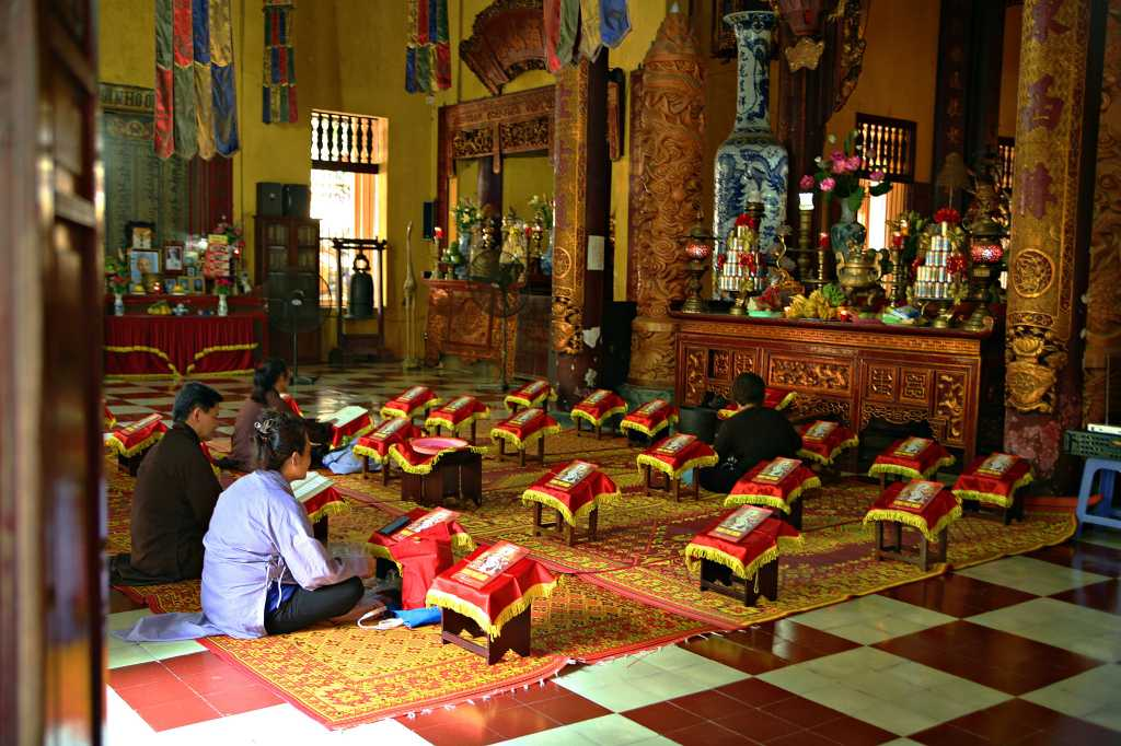 Devotees Praying at Quan Su Pagoda Hanoi Vietnam