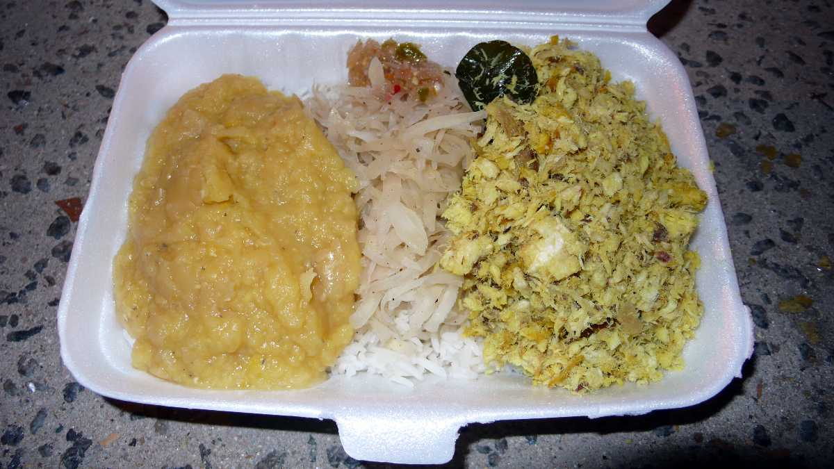 Shark chutney served, with green shredded papaya on rice and lentils, in one of the restaurants in Mahé island in Seychelles.