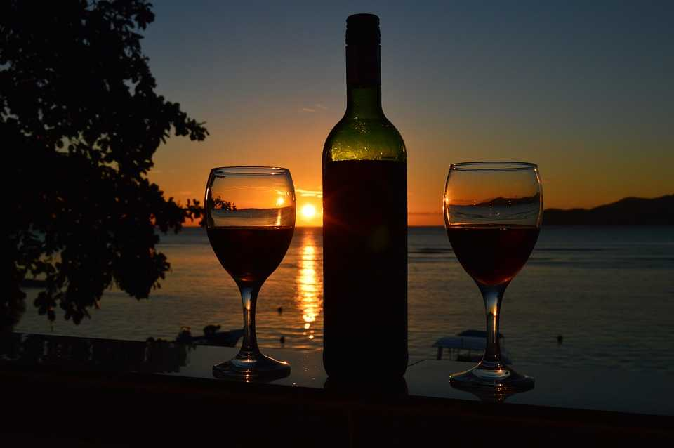 Enjoy afterglow of sunset in Seychelles with a glass of wine