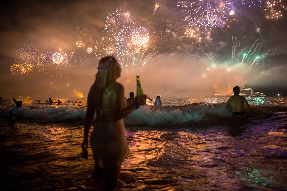 Jumping Waves And Offering Flowers In Brazil