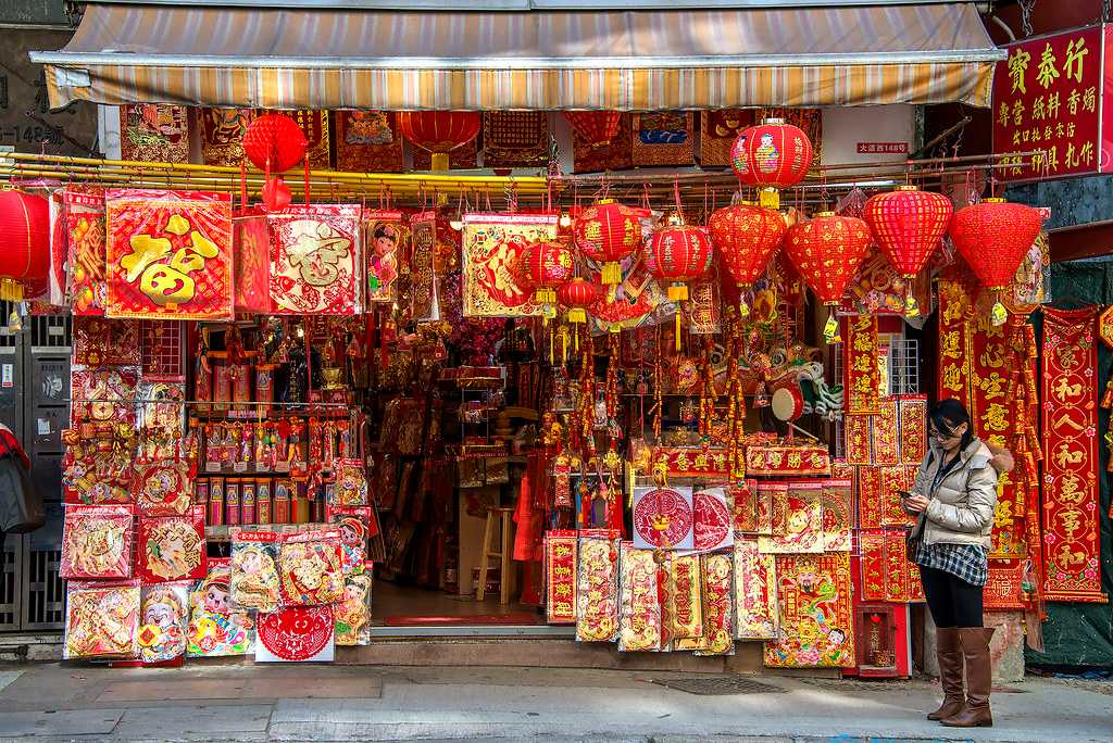 Traditional red velvet paper patterns and lanterns being sold during the Chinese New Year in Hong Kong