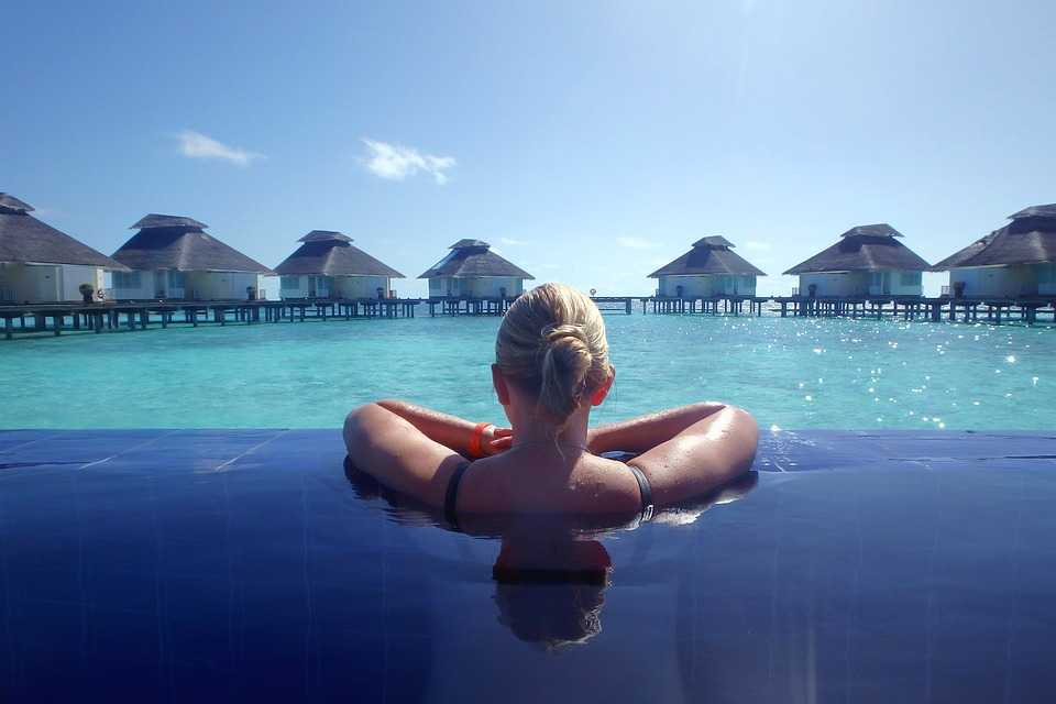 Woman in an infinity pool in Maldives