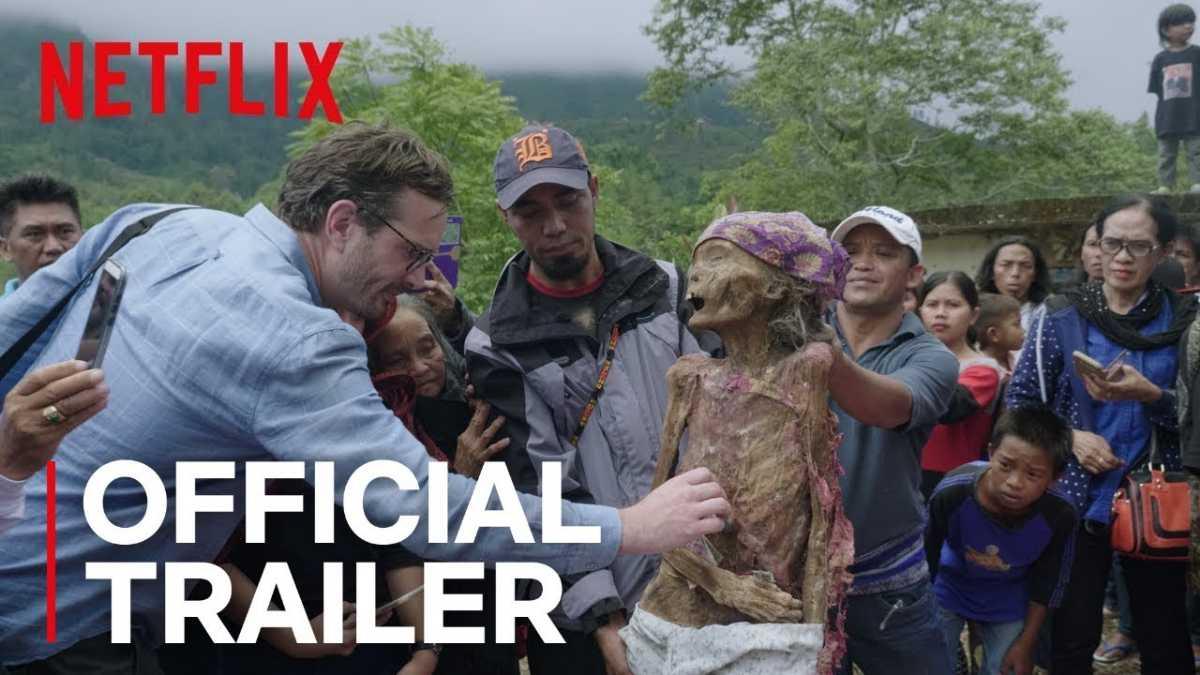 David Farrier touching mummified body
