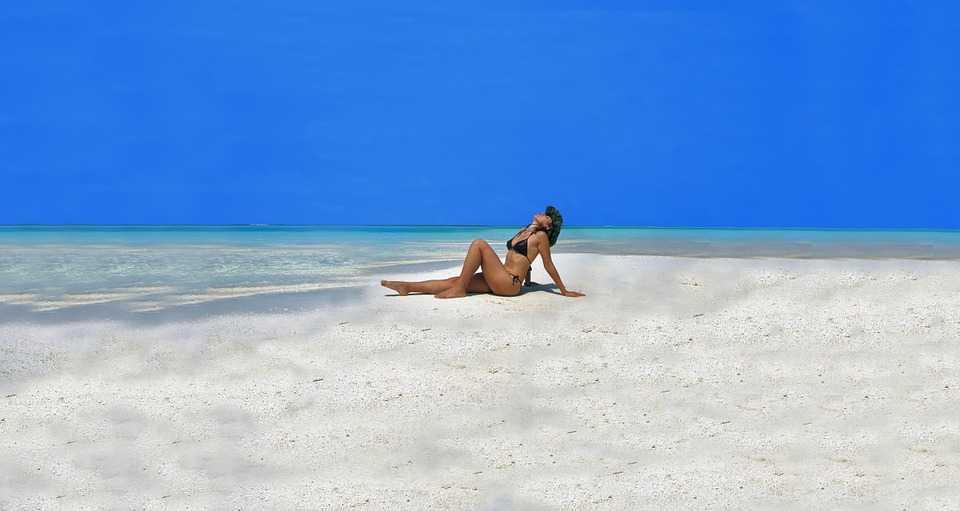Woman at Dhangethi Bikini Beach in the Maldives