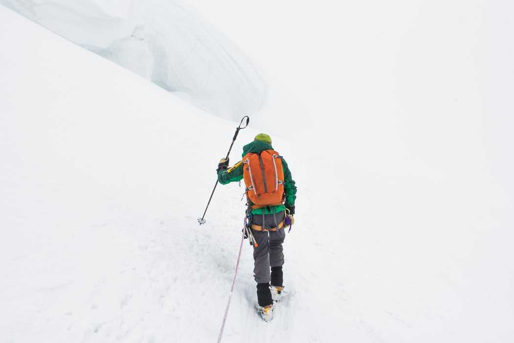 Man trekking in the Indian Himalayas under heavy snowfall