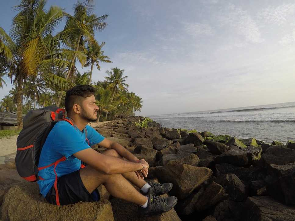 Backpacker resting near a beach