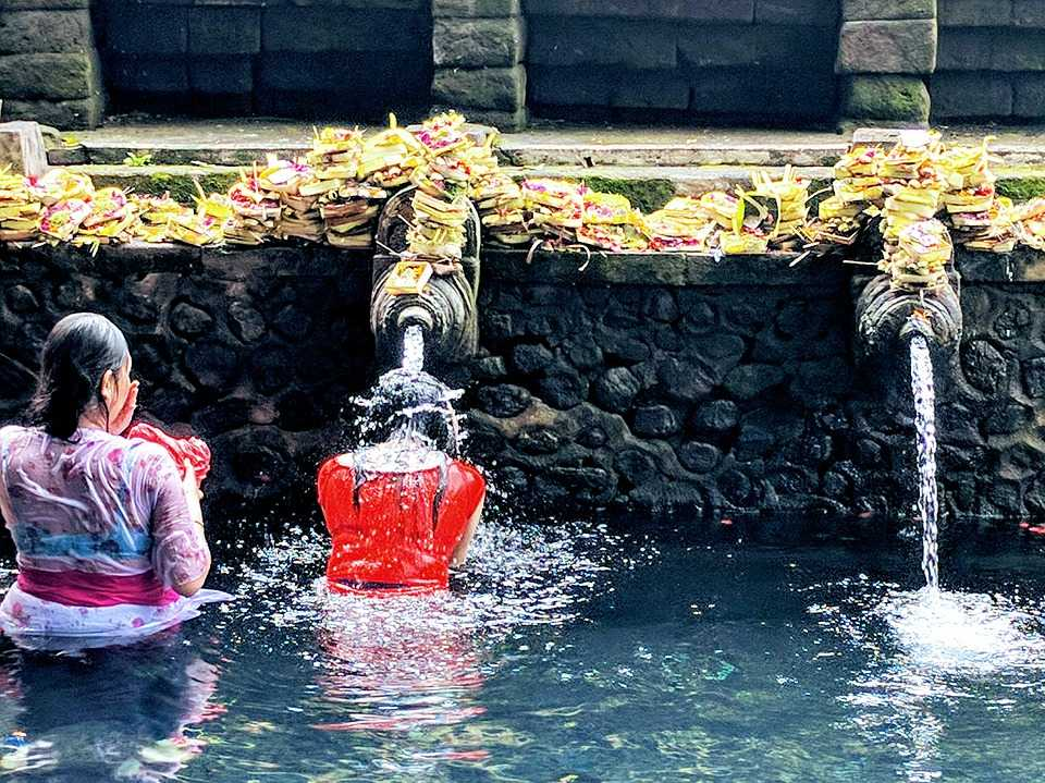 Devotees at Tirta Empul, one of the most famous and iconic Hindu Temples in Bali