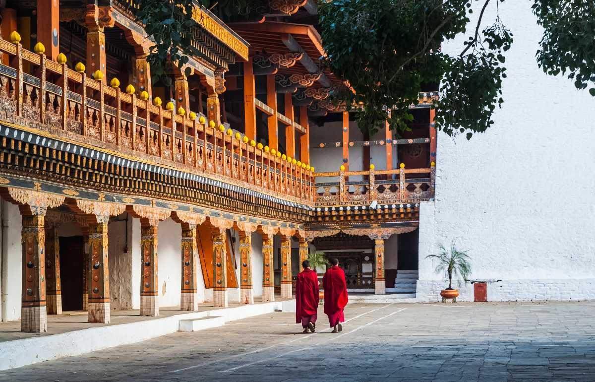 Two buddhist monks at Punakha Dzong, Bhutan