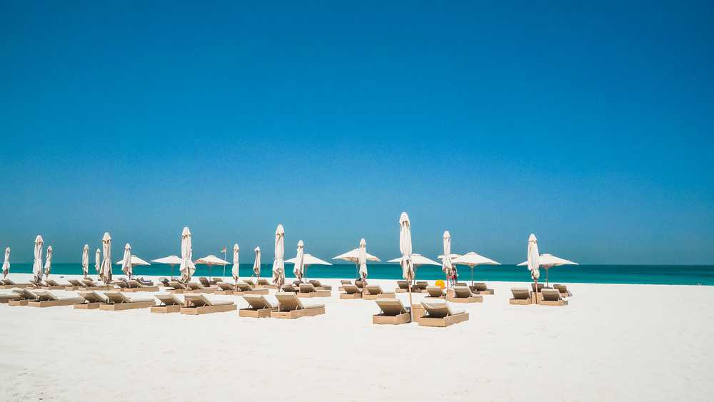 lounge chairs available for visitors on saadiyat beach