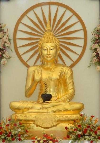 Gold coated statue Buddha Vihar