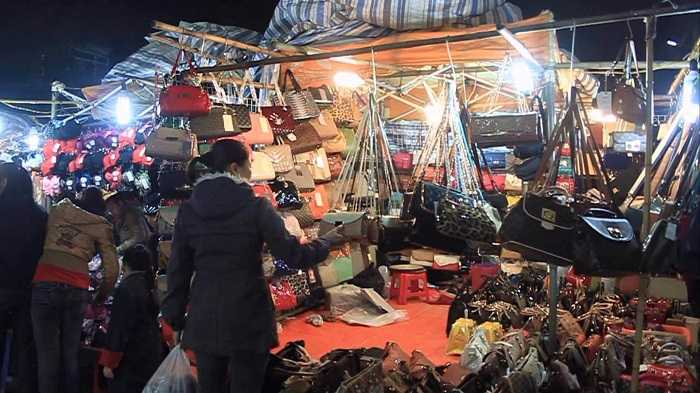 Shopping at old quarter night market in hanoi